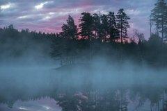 Før soloppgang ved en innsjø i Østfold
